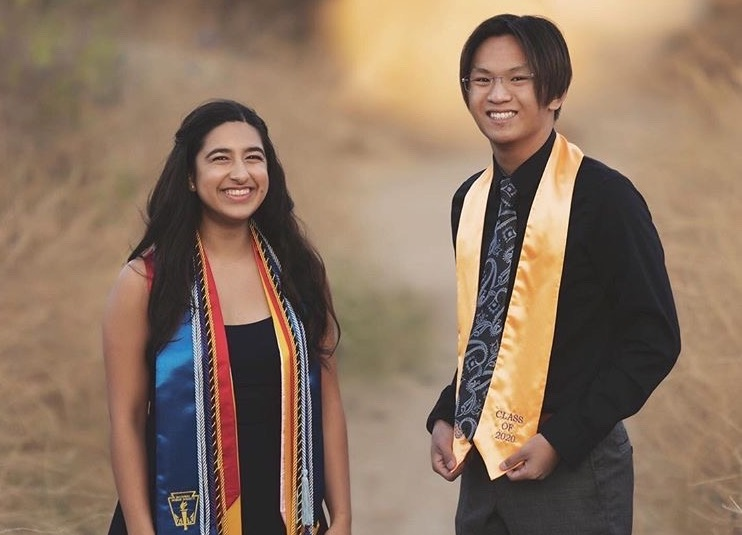 Class+of+2020%27s+Johnathyn+Yip+and+Elena+Singh%2C+wear+their+Sunny+Hills+cap+and+gowns+at+a+senior+graduation+photoshoot+at+the+Brea+Dam+on+June+28.+The+Class+of+2020+not+only+lost+its+senior+traditions+like+prom%2C+Grad+Nite+and+paper+toss%2C+but+last+school+year%27s+seniors+also+never+had+a+chance+to+walk+down+the+aisle+to+pick+up+their+diplomas+during+a+commencement+ceremony+usually+held+at+Fullerton+Union+High+School%27s+football+stadium.+An+Aug.+5+makeup+graduation+at+Buena+Park+High+School%27s+football+stadium+was+canceled+July+28+because+of+the+continued+increase+in+COVID-19+cases+in+Orange+County.