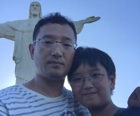Junior Edward Cho (right), who will attend Sunny Hills virtually this year from his home in São Paulo, Brazil, stands with his father in 2015 in Rio de Janeiro, Brazil.