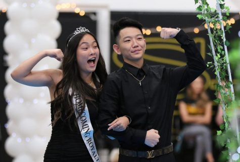 Homecoming princess Rachel Kim (left), escorted by Kenji Williams (both Class of 2020), celebrate their walk around the gym during the 2019 ASB-organized assembly. Because football got postponed to the spring semester of 2021, the ASB has decided to move its traditional fall homecoming events to the week of Feb. 9.