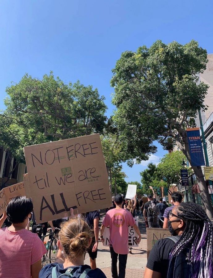 Senior Hanna Oltman uses her iPhone 11 to take an image of protestors in Downtown Fullerton on June 7 chanting for justice after the death of George Floyd.