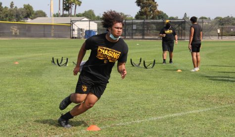 Linebacker senior Noah Brown runs around a cone during a June 23 football practice on the Sunny Hills baseball field. Practices would be suspended two weeks later on July 6 before resuming on Aug. 17 but have since been shut down again because of possible COVID-19 exposure.