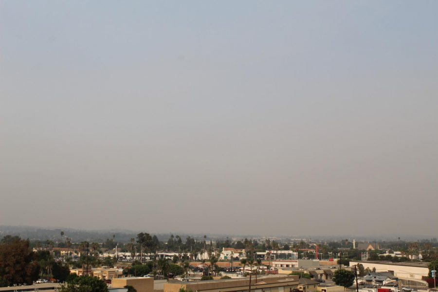 Ash and smog fills the northern horizon as a consequence of the El Dorado wildfires on Sept. 11 in Buena Park.