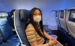 Buckled and ready for her first cross-country flight during the coronavirus pandemic, senior Karen Lee sits in her seat on Delta Air Lines as she waits for the pilot to take off from Los Angeles International Airport. The Accolade's online graphics editor was excused from school for part of Aug. 14 and the whole day of Aug. 17 so she could travel with her parents and older brother, Daniel, to Georgia's Emory University in Atlanta, where Lee's brother will be attending his first year of college. Like several other businesses nationwide, airline passengers are required to wear a face mask before they board their flight.