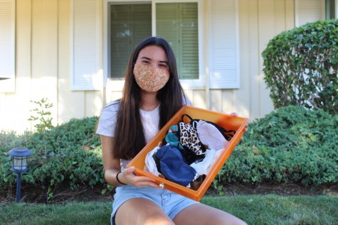 Senior Meagan Kimbrell takes out her collection of 30 masks that she has bought either from Amazon or Target since the COVID-19 pandemic in mid-March. Though Kimbrell does not plan to return to campus Nov. 2 for hybrid learning, she still values mask fashion and will continue to promote her new finds on social media.