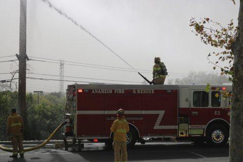 A firefighter standing upon Anaheim Fire Department