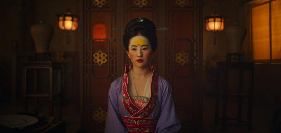 Actress Liu Yifei plays Mulan, whose family has her dressed up to impress the local Chinese village matchmaker in the live-action movie based more on the original Chinese story than the 1998 original animation.