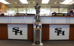 The Winston the Lancer statue sits above the touch-free sanitizing unit placed in the main office in Room 3. Custodians have placed one touch-free sanitizing unit identical to this one in every single classroom for students to utilize as they enter or leave.