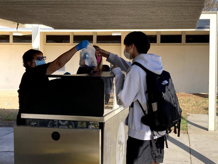 A student receives a free breakfast outside of the 70s building on Nov. 6.