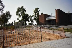 The area in front of the building is enclosed with fences in preparation for the ongoing school construction of the landscaping of the PAC, which will include the installation of a retaining wall.