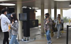 Students walk through the new, $15,000 thermal cameras between the 20s wing and the office on Nov. 2, the first day of the hybrid schedule at Sunny Hills.