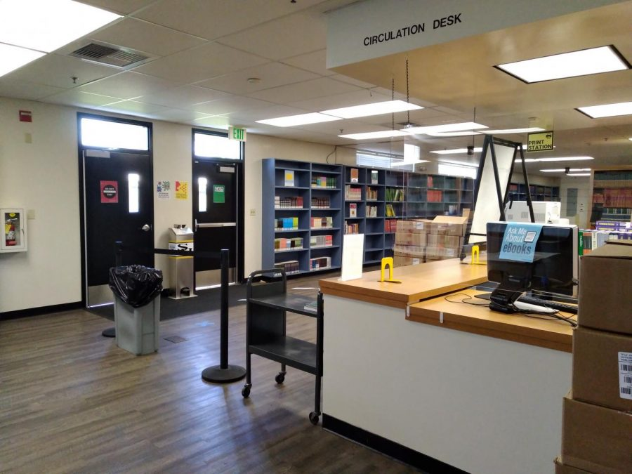 School officials have placed plexiglass in front of the checkout counter of the campus library as one of several other COVID-19 health and safety measures added inside. Since Sunny Hills reopened Nov. 2 for live classroom instruction, the library has also opened with updated hours for students to use, though the maximum amount that can be inside at a time has been reduced by 24%.