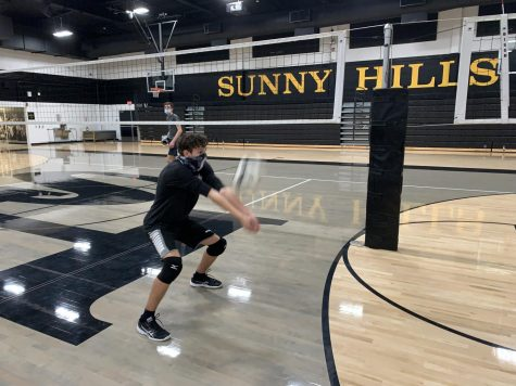Junior Sebastian Bonca (front) sets the volleyball while practicing his receives during a Nov. 18 practice in the Sunny Hills gym.