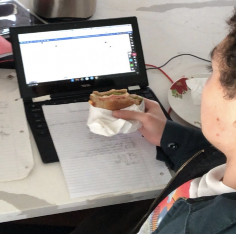 Junior Guillermo Soto attends class while eating a burger. Like many other Sunny Hills students, Soto elected to stay at home when the hybrid schedule begins on Nov. 2.