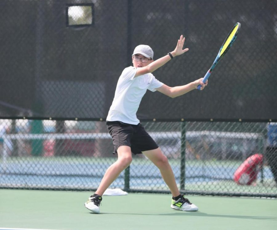 Sophomore Carson Lee hits a forehand in the 64 consolation round at the USTA Boys' 14 and Boys 12' National Championships in June of 2018.