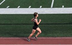 Senior Esther Fee races to the finish line at a 2019 track and field meet at Buena Park High School.