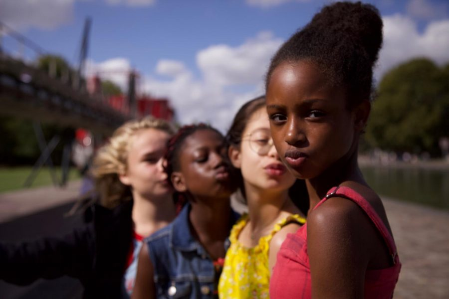 "Netflix's ""Cuties"" focuses on lead actress 11-year-old Fathia Youssouf as Amy (far right) on a free-spirited dance team but has since received criticism for its sexualization of its child actors."