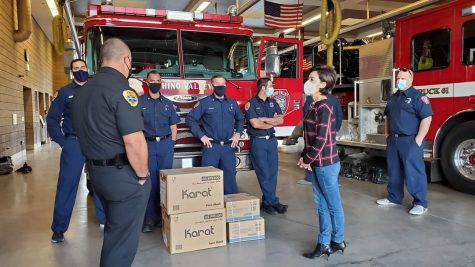 After donating masks and hand sanitizers with Karat Packaging, Young Kim (right) meets with firefighters from the Chino Valley Fire District on Nov. 25.