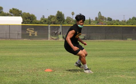 Linebacker senior Kevin Hu runs around a cone during a June 23 practice. The Lancer football team currently practices Monday-Thursday from 3:30-5:00.