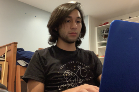 Junior Zachary Gomez uses his laptop to browse UCLA