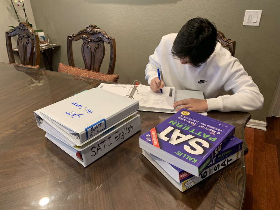 Junior Daniel Kong finishes the last of his SAT Prep material from Sapient Academy. Rescheduled in March, Kong's test has been canceled four times because of the COVID-19 pandemic.