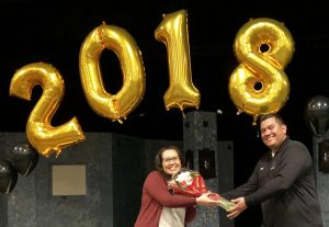 Sonya Joyce (left) accepts a bouquet of flowers from head custodian Daniel Rodriguez in February of 2018 when Joyce received the most votes from the Sunny Hills staff for classified employee of the year. The 2017-2018 school year was also when Joyce was first hired as a site technician on campus in charge of servicing technology issues. Joyce retired from the position Jan. 22.