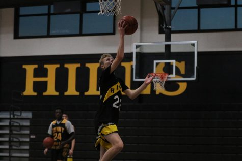 Boys basketball shooting guard senior Caleb Harnett jumps up for a layup in the gym during a Nov. 14, 2019 practice. Tryouts for the boys basketball team are set to be held Feb. 6 at 10 a.m. to 11:30 a.m. on the outdoor sports courts.