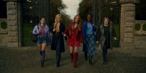 The Winx Club fairies -- Musa (left), Stella, Bloom, Aisha and Terra -- walk through the gates of Alfea, a magic school for fairies, after returning from a trip to Earth. The Netflix series was released Jan.22
