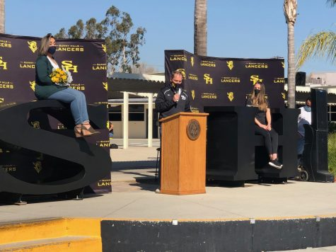 Keeping with the campus' health and safety protocol of remaining six feet apart, principal Allen Whitten (center) leads a ceremony Thursday during break announcing Sunny Hills' employees of the year.