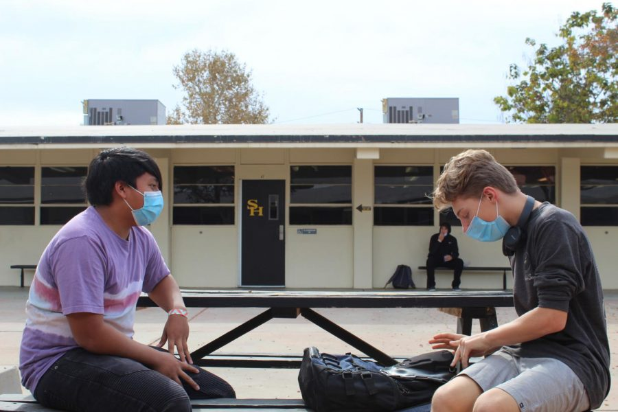 Before Fullerton Joint Union High School District campuses reopen for the hybrid leaning model Feb. 16, administrators and staff will revisit the health and safety protocols to ensure that all who arrive for instruction will abide by them. During past board meetings, some have expressed concerns over whether students were being reminded to remain six feet apart at all times like these Sunny Hills students were trying to do Nov. 5, three days after hybrid learning first started.