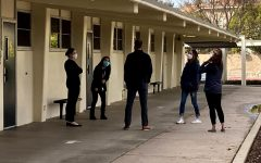 Principal Allen Whitten (center) catches up with four teachers outside of the 90s building during break on Feb. 16. Many Sunny Hills teachers and students returned to school for the first time since December, 2020.