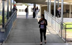Assistant principal Sarah Murrieta (front) patrols the breezeway during break Feb. 16. Murrieta and other administrators walk around campus to help ensure students follow proper coronavirus protocols.
