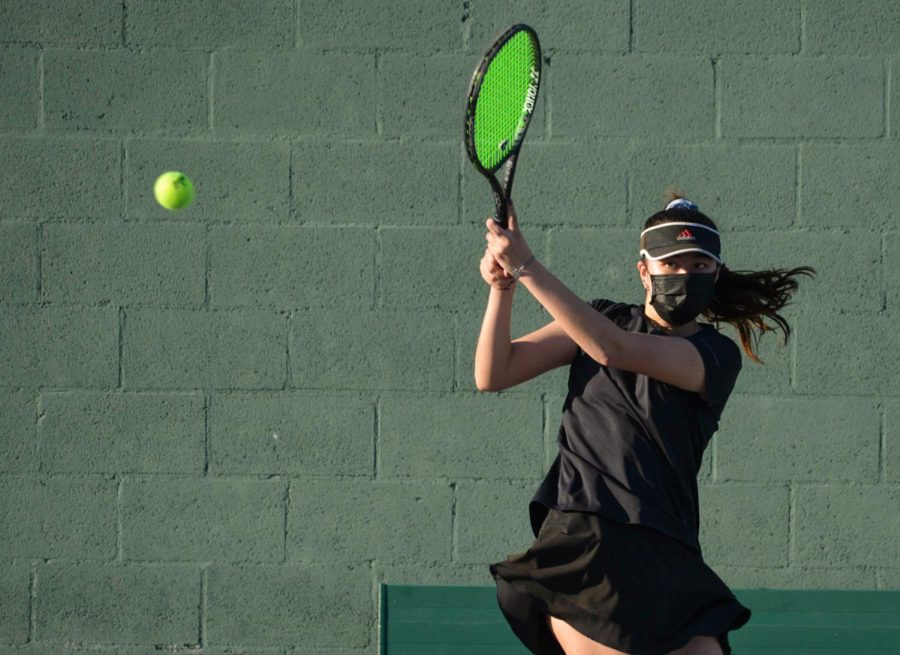 No. 2 singles player junior Nataljia Glavy hits a backhand during a Tuesday, March 2, match against El Dorado High School. Glavy won all three of her sets by the scores of 6-0, 7-5, 6-0, contributing to the Lady Lancers' 73-71 victory.