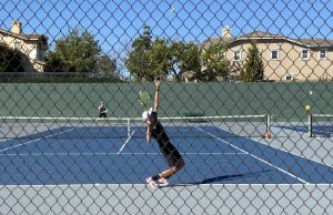 The Lancers' No. 1 singles player, sophomore Owen Taylor, serves during a 6-2 victory over El Dorado's No. 1 singles player, Nathan Chung. Taylor would win one of his two sets en route to a 14-4 Sunny Hills victory over the Golden Hawks on March 1.
