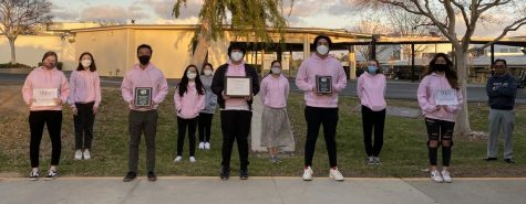 A group of Accolade editors and journalism adviser Tommy Li (right) celebrate Tuesday, March 9, after school outside the 130s wing their recent accomplishments, winning Best of Show plaques for newspaper and online from the Saturday, Feb. 20, Orange County Journalism Education Association writeoffs contest as well as earning the program