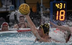 Sunny Hills girls water polo utility player senior Sydney Sereg fights off two Fullerton Union High School defenders while winding up to shoot the ball during a Wednesday, March 3, home game. Sereg scored 10 of the 19 points against the Tribe during the Lady Lancers' season debut.