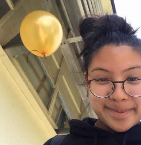 Then-sophomore Gianne Veluz takes a selfie with her Lancer gold helium balloon in the background after she got inducted into the National Honor Society during fourth period in May 2019. While the club is still seeing an interest in new applicants, it has been unable to carry out any of its induction traditions since the coronavirus pandemic broke out a year ago in March.