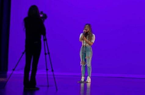 "Senior Charis Lee sings ""Paper Hearts"" by Tori Kelly during the April 10 video recording session for the district-wide talent show at the La Habra High School"