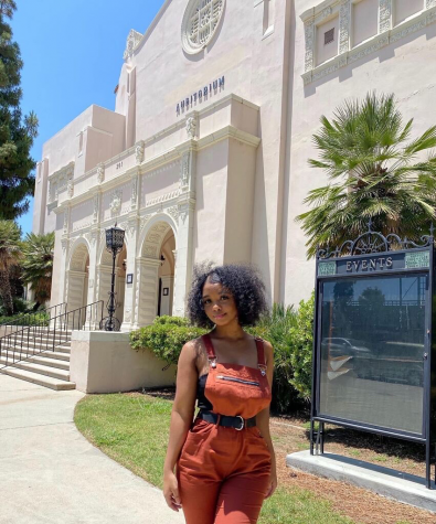 Sunny Hills alumna Jackie Logwood stands in front of the Fullerton Auditorium June 19, three days after the Fullerton Joint Union High School District board of trustees voted unanimously to remove Louis E. Plummer's name from the building. Logwood had created an online petition seeking the change in name after Plummer was alleged to have been involved with the KKK.