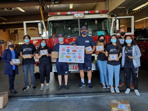The Sunny Hills and Brea Olinda robotics team, along with principal Allen Whitten (top right corner of the group) and a few firefighters held the care packages that were delivered to the frontline workers on Jan. 18, Jan. 20 and Jan. 22 for their service during the COVID-19 pandemic.