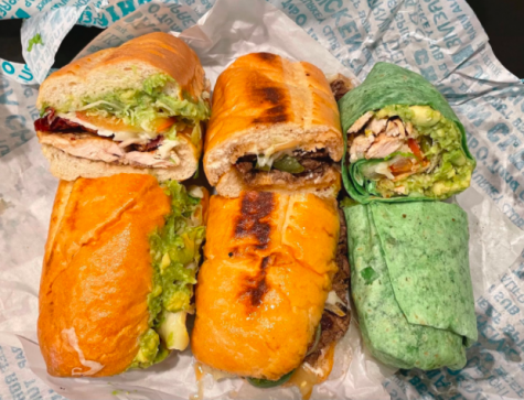 Board and Brew makes all of its sandwiches — including the $9.50 Chicken Club (left), $12.95 Baja Beef and $8.95 Baja Wrap — with fresh ingredients and its secret, gluten-free, nut allergy free, vegan-friendly sauce.