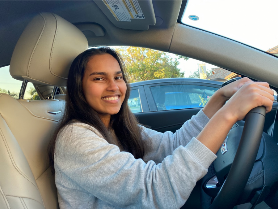 Junior Manishi Jayasuriya celebrates getting her driving permit from the Department of Motor Vehicles [DMV] in Fullerton. Jayasuria has been waiting for a month to take her DMV permit test because the facility has been closed because of COVID-19 health and safety protocols.