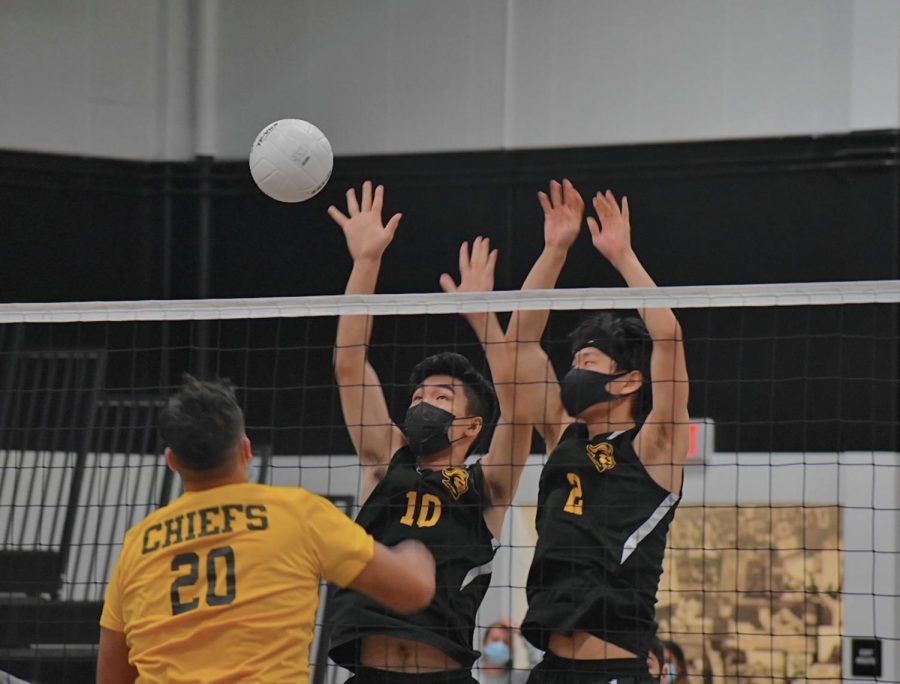 Sunny Hills boys volleyball middle blocker senior Julian Kim (left) and opposite hitter senior Joseph Pak jump up, blocking the opponent's spike during the fourth set Tuesday, May 18. The Lancers hosted their first California Interscholastic Federation-Southern Section playoff at home against Santa Fe High School.