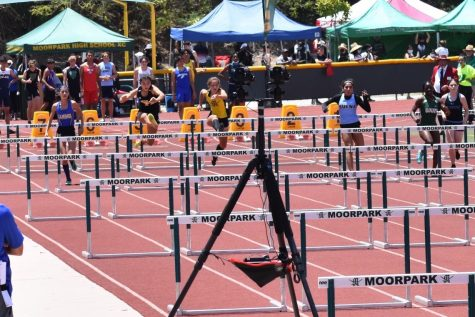 Rising senior Abigail Hahm jumps to victory as she sprints toward the finish line during a 100-meter hurdle event June 5 at Moorpark High School. Hahm placed first in her heat with a personal best of 16.54 advancing to the California Interscholastic Federation Finals June 12.