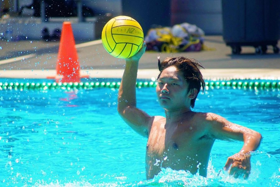 Senior Nathan Kim passes the ball to his teammates during drills in summer practice Aug. 5 at the Sunny Hills pool.