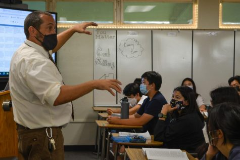New English teacher Thomas Butler goes over his goals for the beginning of the school year with his sixth period sophomore honors English class.