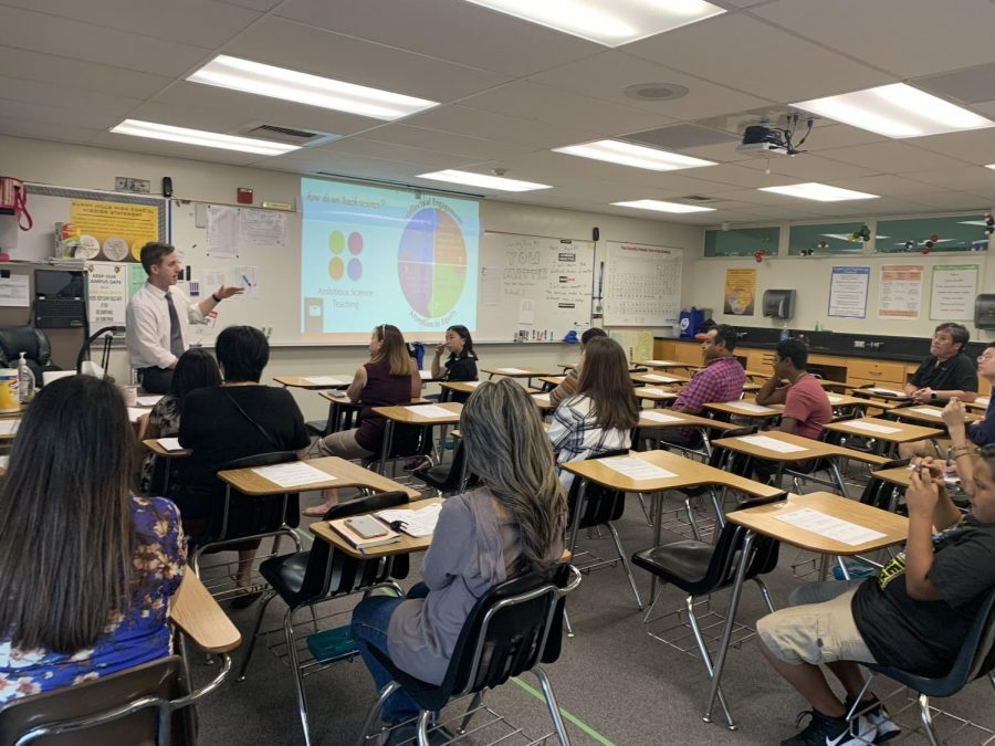 Chemistry teacher Walter Haberaecker introduces his class curriculum for families attending a 2019 Back to School Night. This year's event has a hybrid option.