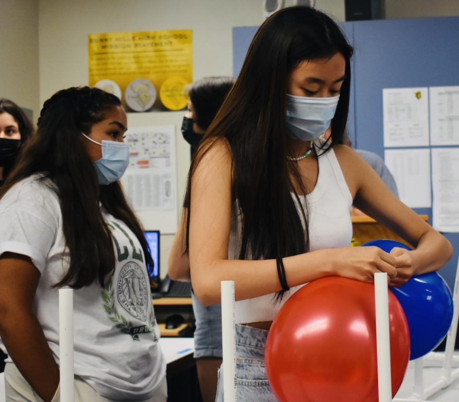 Junior Lindsey Kang ties a red and blue balloon together during the junior class secretary's fifth period Associated Student Body [ASB] class on Thursday, Sept. 9. The ASB plans to decorate the quad with such patriotic colors Friday, Sept. 10, before break, when the ceremony to remember the lives lost during 9/11 will take place.