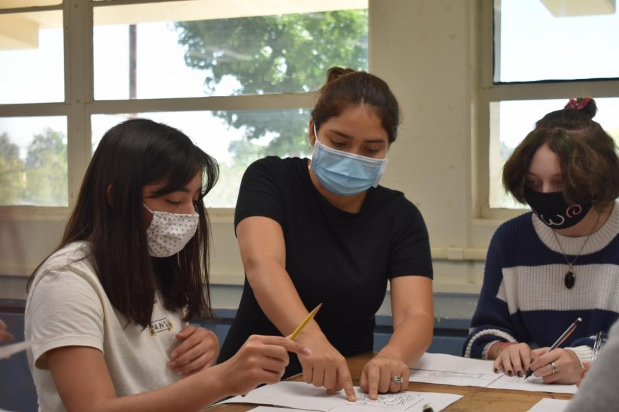 New Drawing and Painting teacher Vashtty Lemus guides her students through an assignment during an Aug. 26 class.