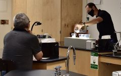 Chemistry teacher Andrew Colomac performs an experiment to the parents of his second period AP Chemistry class.
