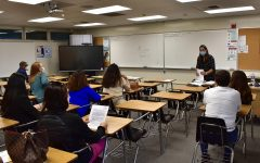 Spanish teacher Vanessa Lara passes out information regarding her class to parents during Back to School Night Aug. 31 in Rm. 56.
